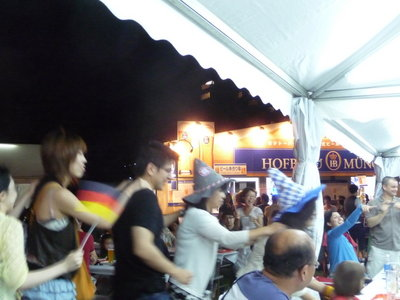 Conga-dancing people at an Oktoberfest in Tokyo