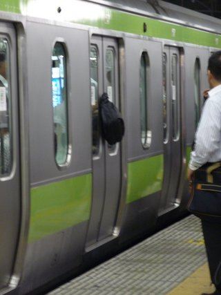 Whoops - rucksack stuck in the door of a Yamanote Line train